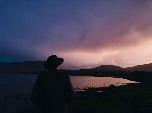 silhouette photography of person near sea